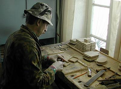 Craftsman making a papier mache Box